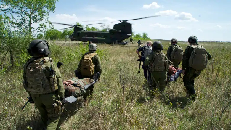 James Alexander Michie | Canadian soldiers move towards a Chinook