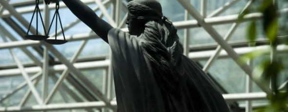 A statue of Justice is seen outside B.C. Supreme Court in Vancouver James Alexander Michie