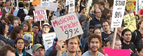 Occupy Oakland 99 percent signs Explaining Capitalism | James Alexander Michie