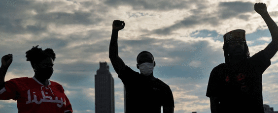 People raise their fists in Atlanta National Post | James Alexander Michie